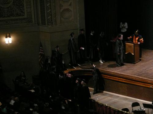 Jim waves at his graduation
