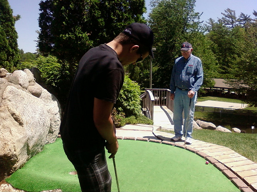 Tommy and Grandpa mini-golfing